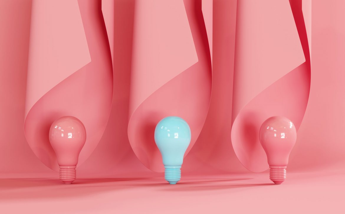 Blue,Light,Bulb,On,Pink,Background,With,Pink,Curve,Shape.
