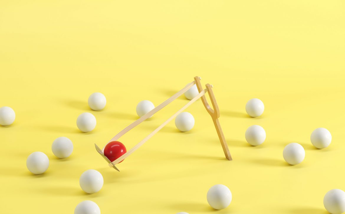 Outstanding,Red,Ball,In,A,Slingshot,Surrounded,By,White,Balls