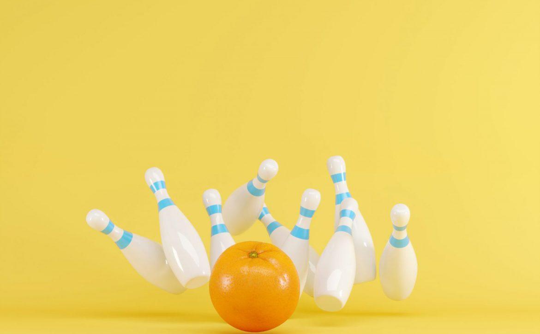 Orange,Fruit,Strike,With,Bowling,On,Yellow,Background.,Fruit,Minimal